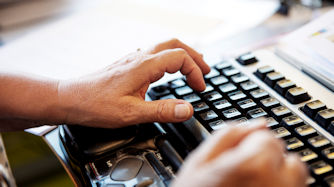 Person with a computer keyboard